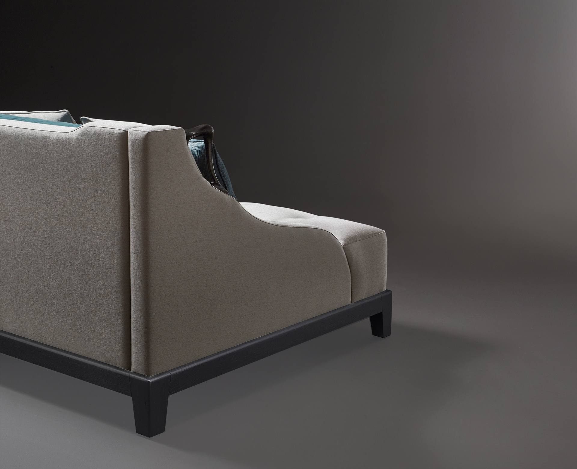 Detail of Albert, a wooden sofa covered in fabric with two bronze handles on the sides, from Promemoria's catalogue | Promemoria