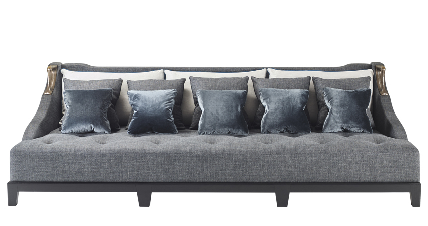 Albert is a wooden sofa covered in fabric with two bronze handles on the sides, from Promemoria's catalogue | Promemoria