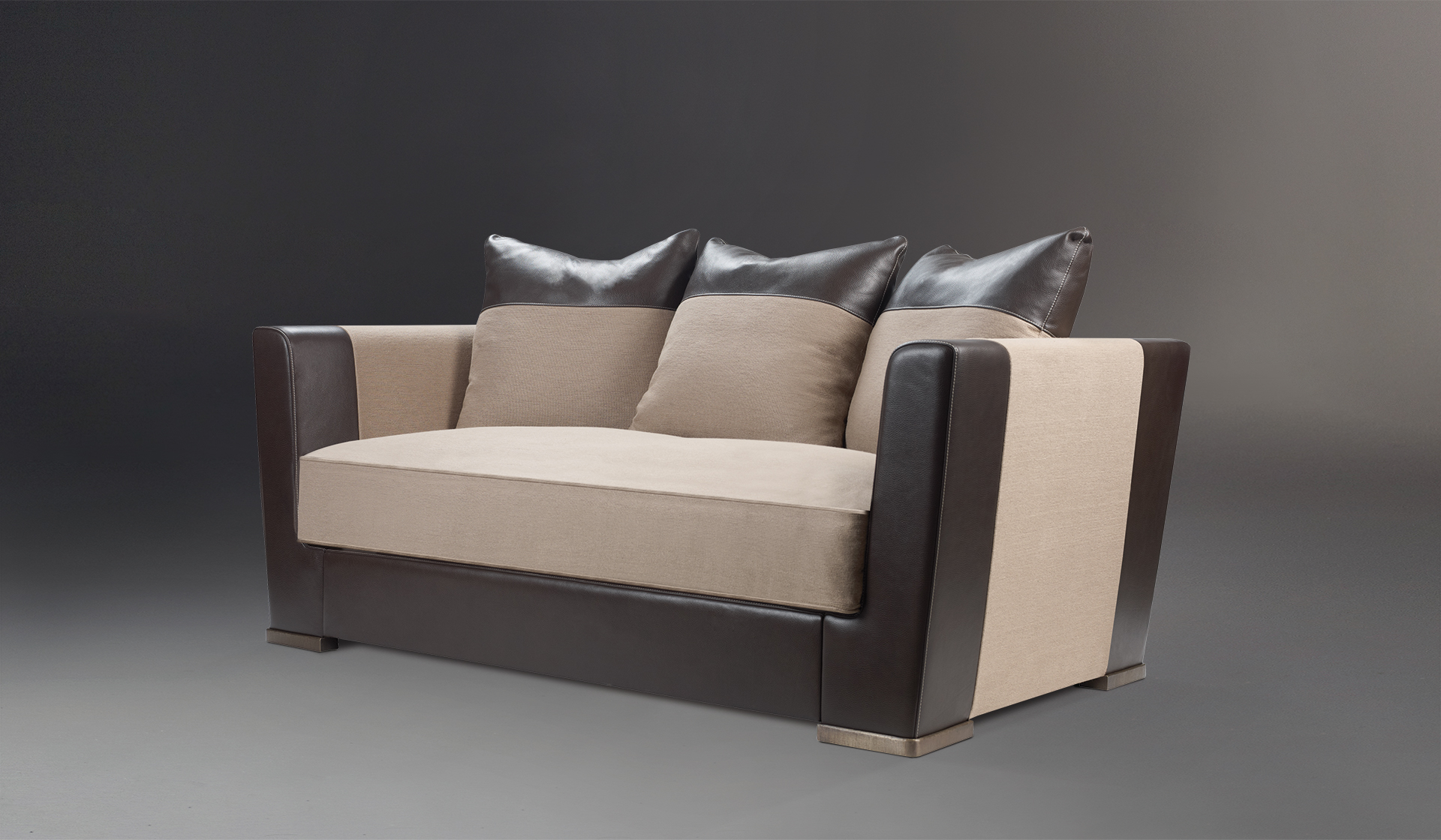 Dolce Vita is a sofa covered in fabric with leather details and bronze feet, from Promemoria's catalogue | Promemoria