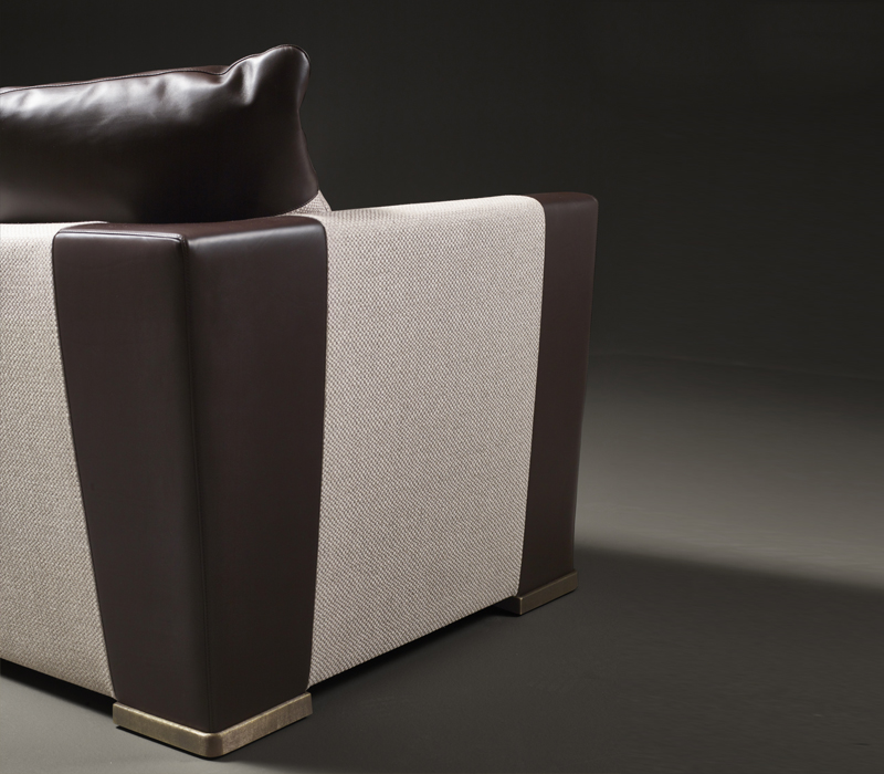 Leather details of Dolce Vita, a sofa covered in fabric with bronze feet, from Promemoria's catalogue | Promemoria