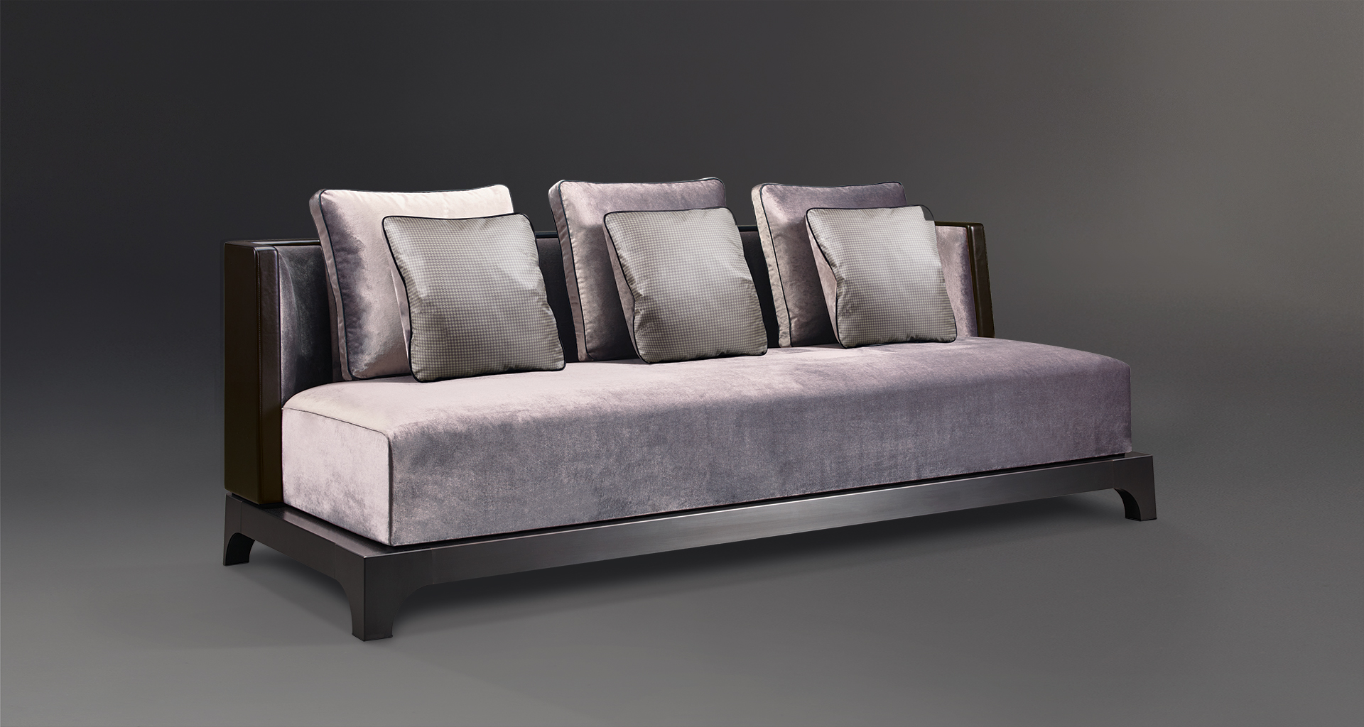 Eaton is a sofa with a wooden or bronze base covered in fabric, from Promemoria's The London Collection | Promemoria
