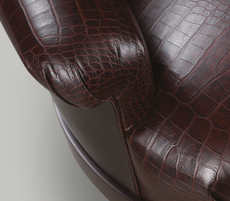Detail of Gacy, a wooden sofa covered in fabric or leather, from Promemoria's catalogue | Promemoria