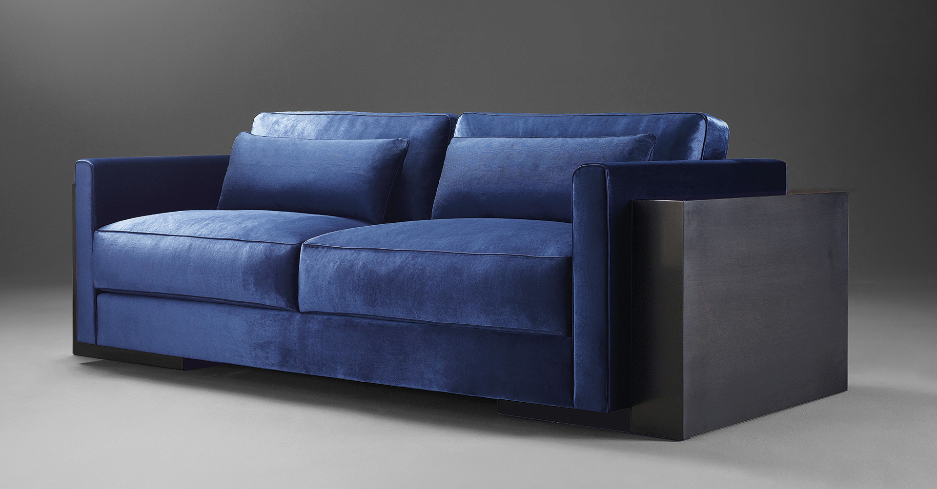 Ipparco is a wooden sofa with seat and back cushions in fabric, from Promemoria's Amaranthine Tales collection | Promemoria