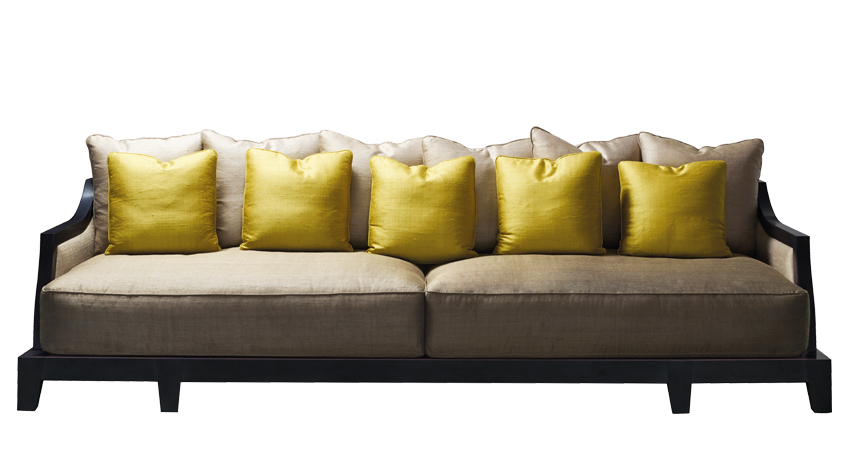 Lisandro is a wooden sofa with fabric covering and cushions, from Promemoria's Amaranthine Tales collection | Promemoria