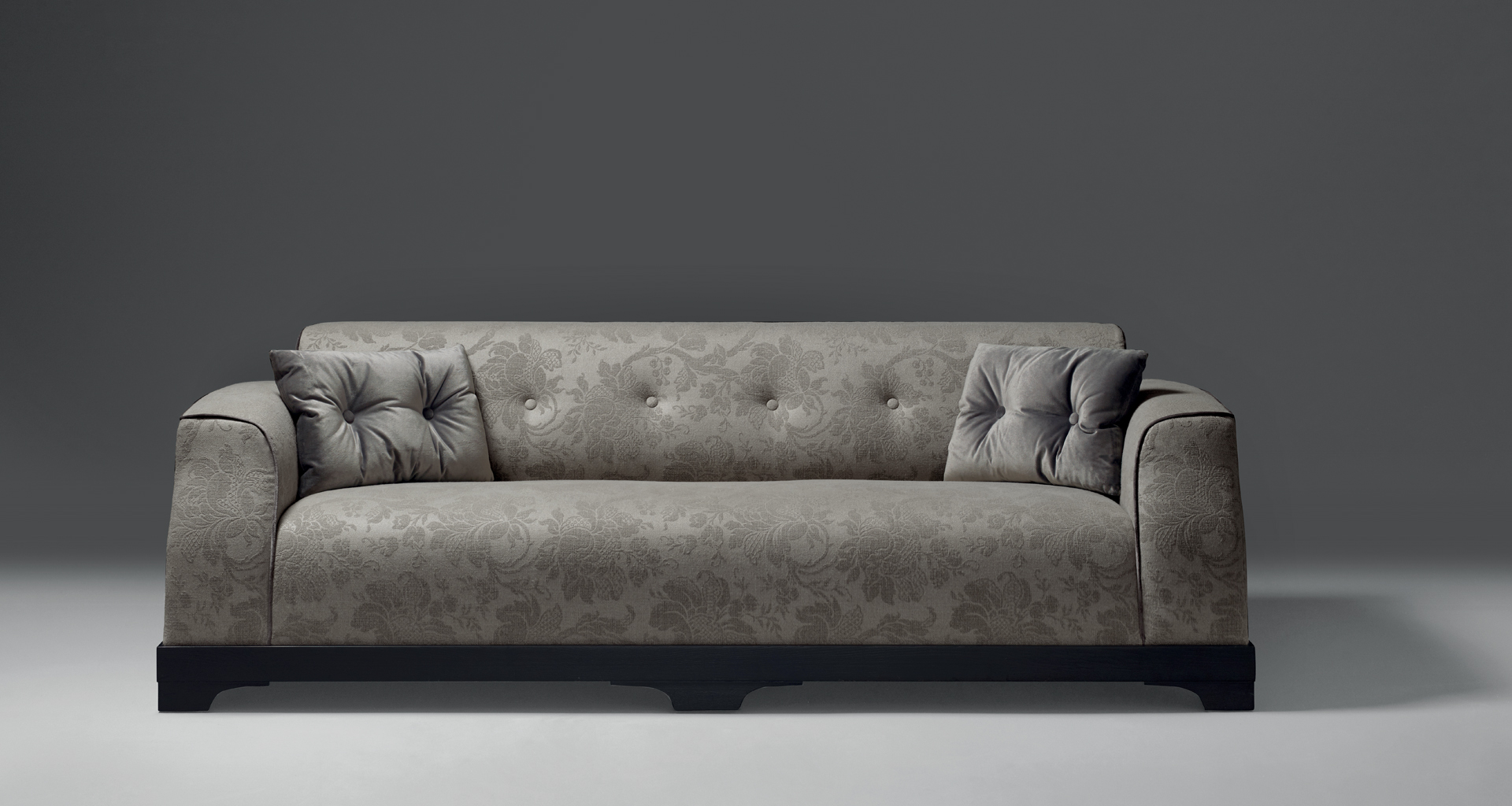 Mogador is a wooden sofa covered in fabric or leather with capitonnè backrest and cushions, from Promemoria's catalogue | Promemoria
