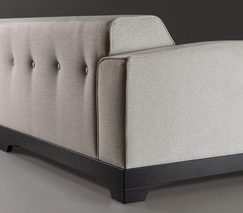 Capitonnè backrest detail of Mogador, a wooden sofa covered in fabric or leather, from Promemoria's catalogue | Promemoria