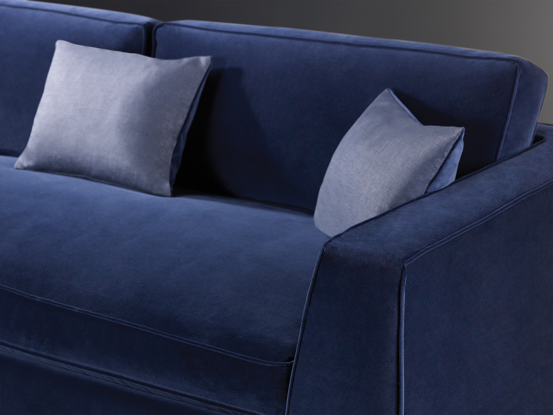 Detail of Oscar, a sofa completely covered in removable fabric, from Promemoria's catalogue | Promemoria