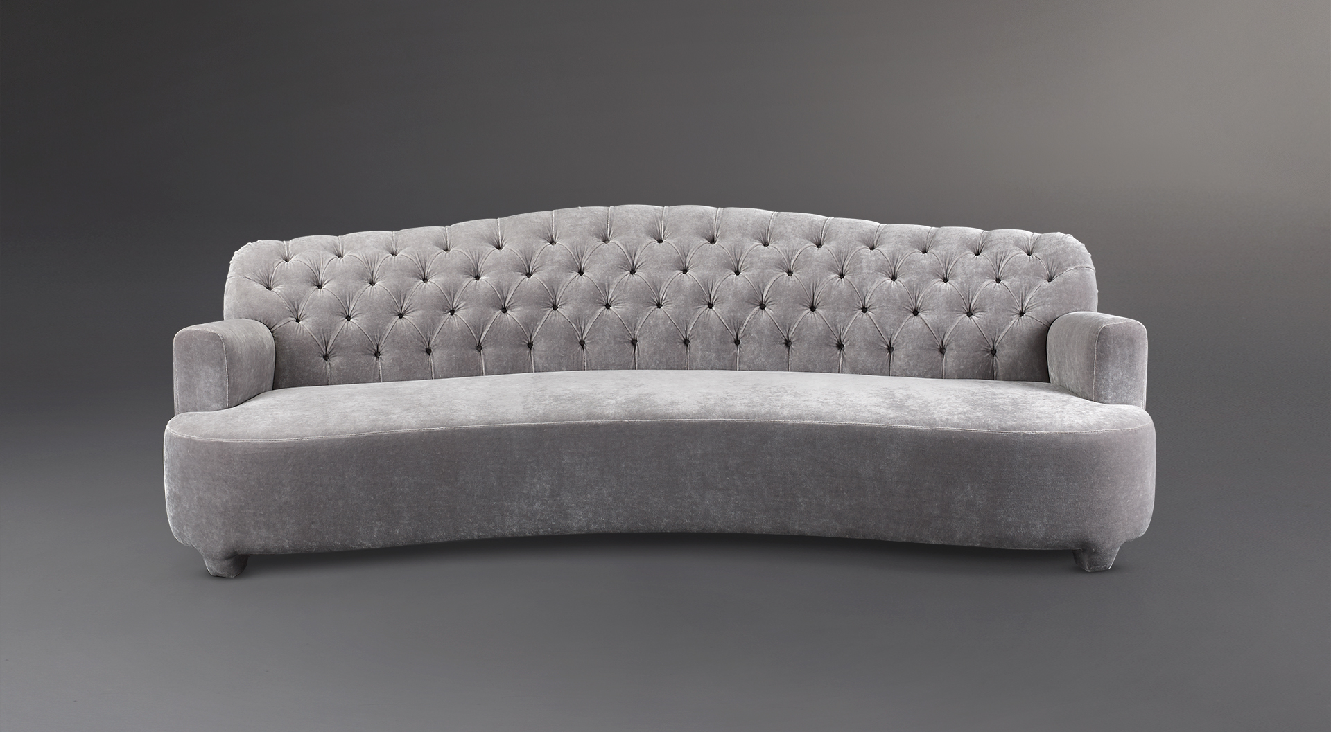 Rodolfo is a sofa covered in velvet with a capitonnè backrest, from Promemoria's catalogue | Promemoria