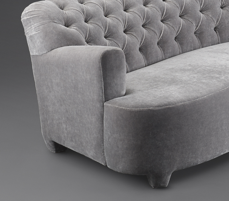 Detail of Rodolfo, a sofa covered in velvet with a capitonnè backrest, from Promemoria's catalogue | Promemoria