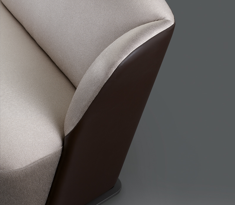 Detail of Rosaspina, a sofa covered in fabric and leather with a metal base, from Promemoria's catalogue | Promemoria