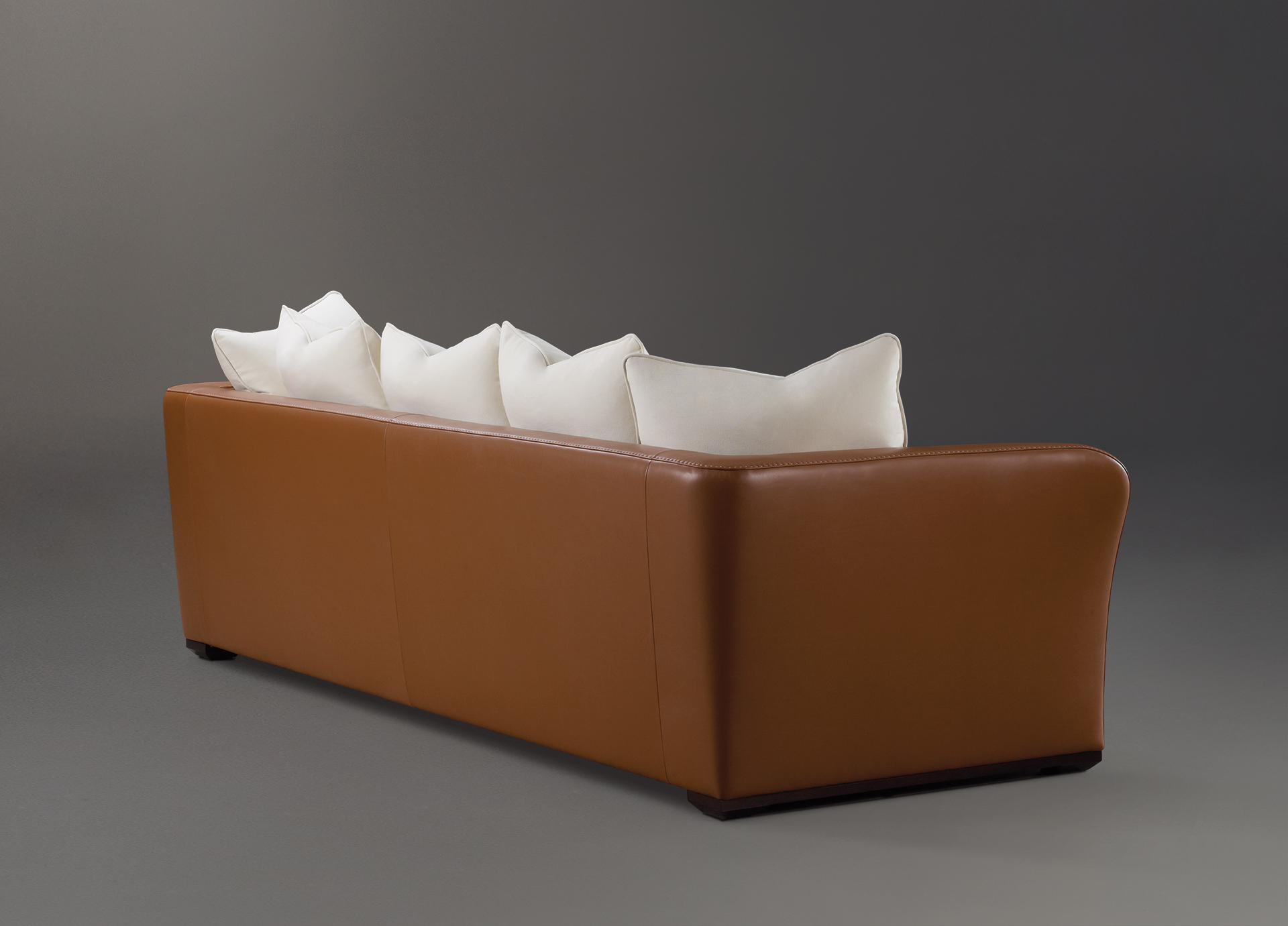 Shangri-la is a wooden sofa covered in leather and fabric, from Promemoria's catalogue | Promemoria