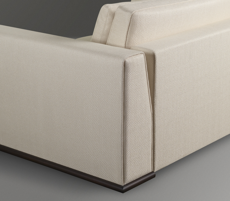 Detail of Ulderico, a wooden sofa covered in fabric or leather, from Promemoria's catalogue | Promemoria