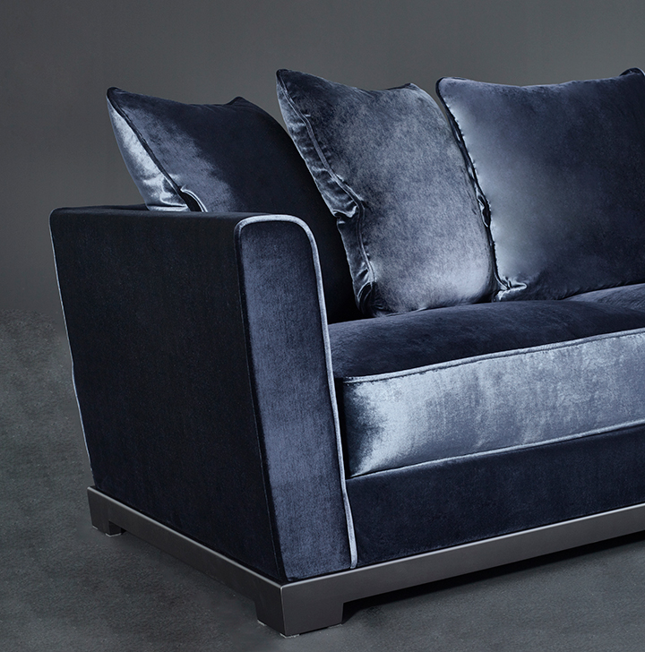 Detail of Wanda, a classic wooden sofa covered in fabric, from Promemoria's catalogue | Promemoria