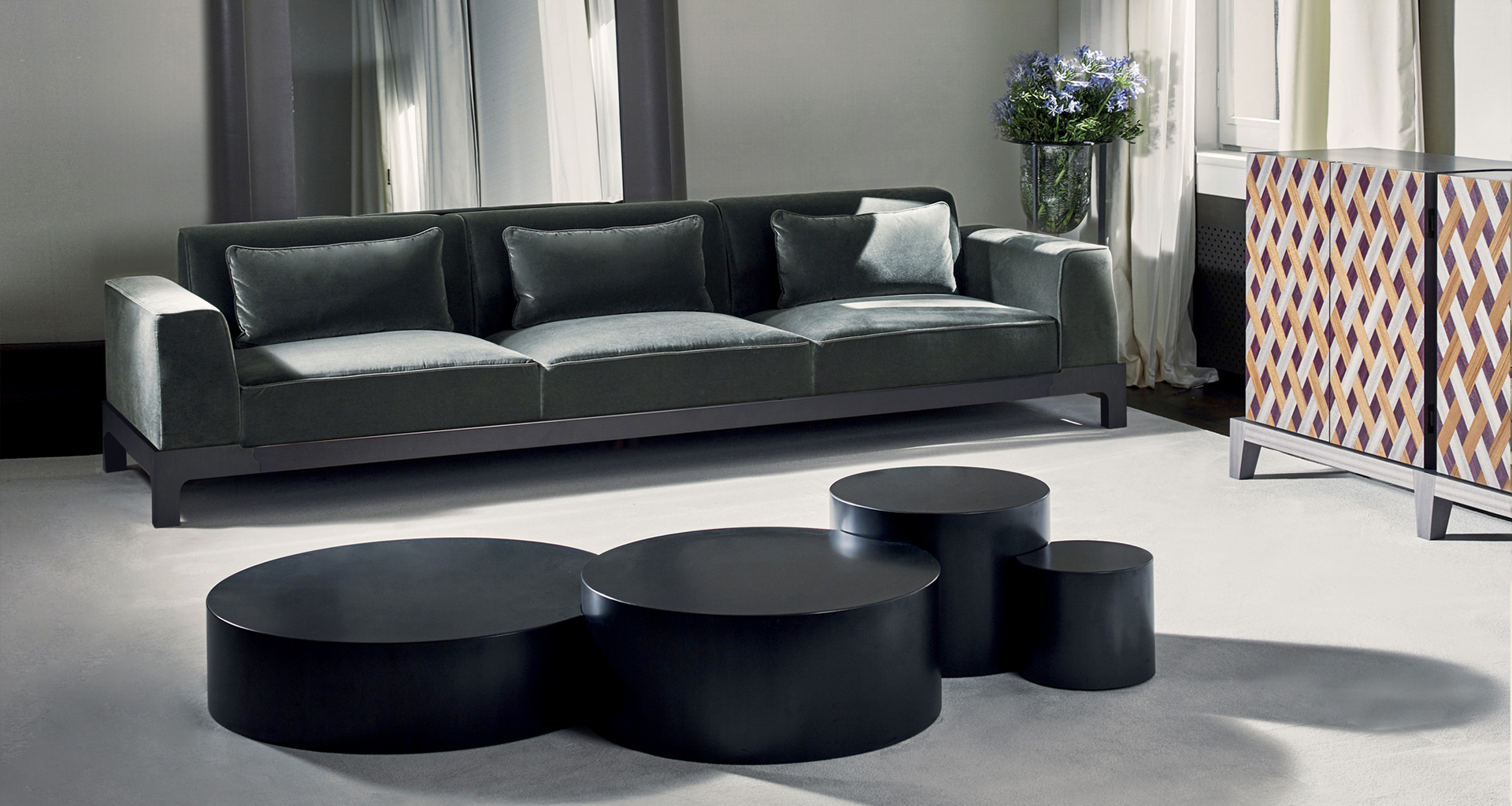 Edon is a bronze coffee table, with four units embedded, from Promemoria's Indigo Tales collection | Promemoria