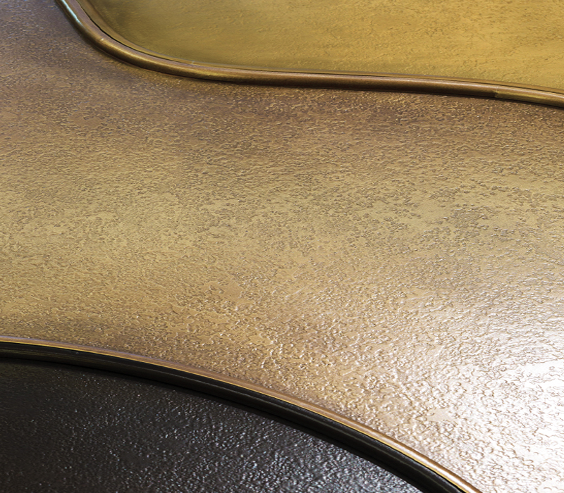 Detail of Moscou, a bronze coffee table with various shades of color, from Promemoria's Capsule Collection by Bruno Moinard | Promemoria
