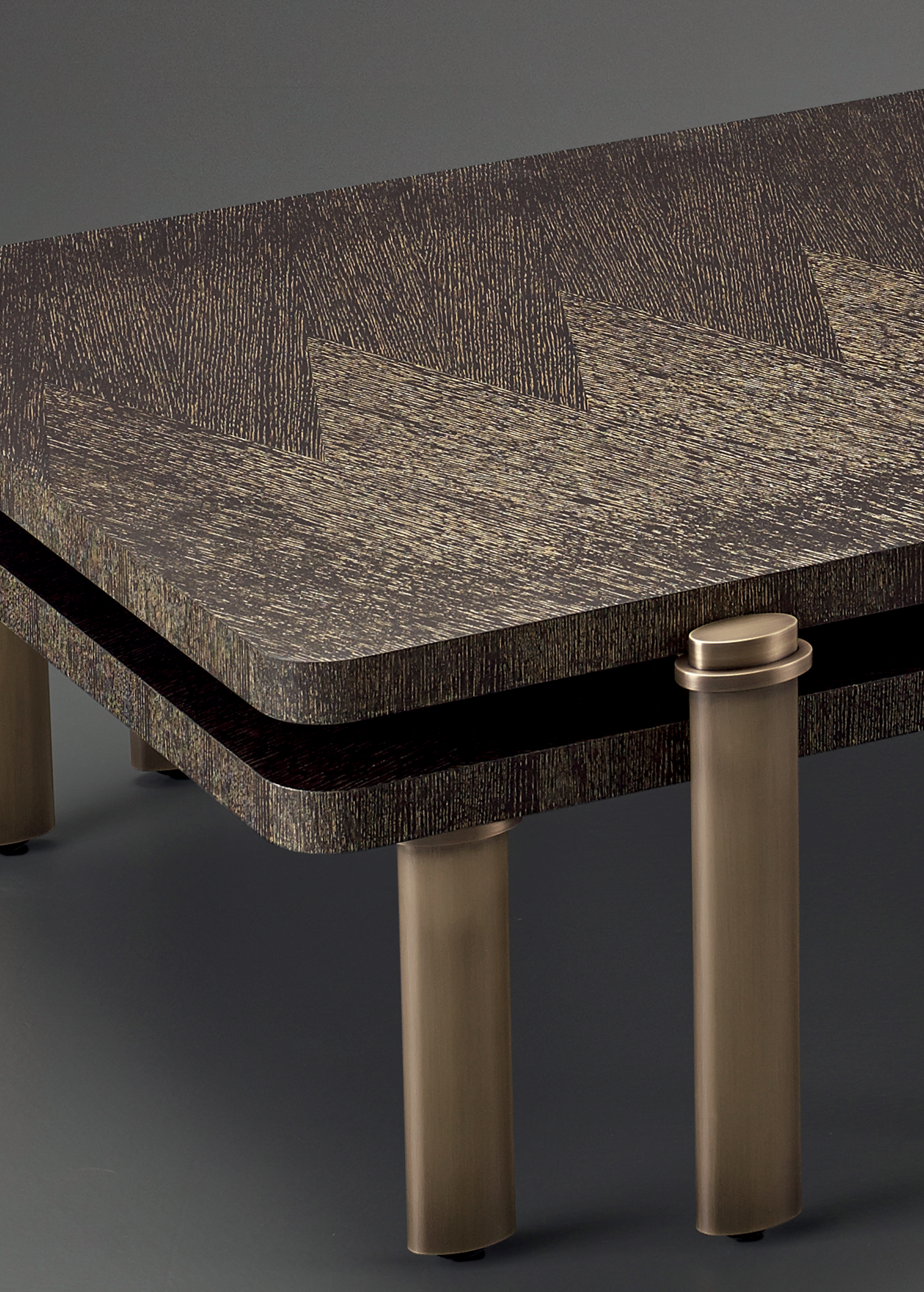 Bronze detail of Passepartout, two wooden coffee tables with wheels and bronze decoration, from Promemoria's catalogue | Promemoria