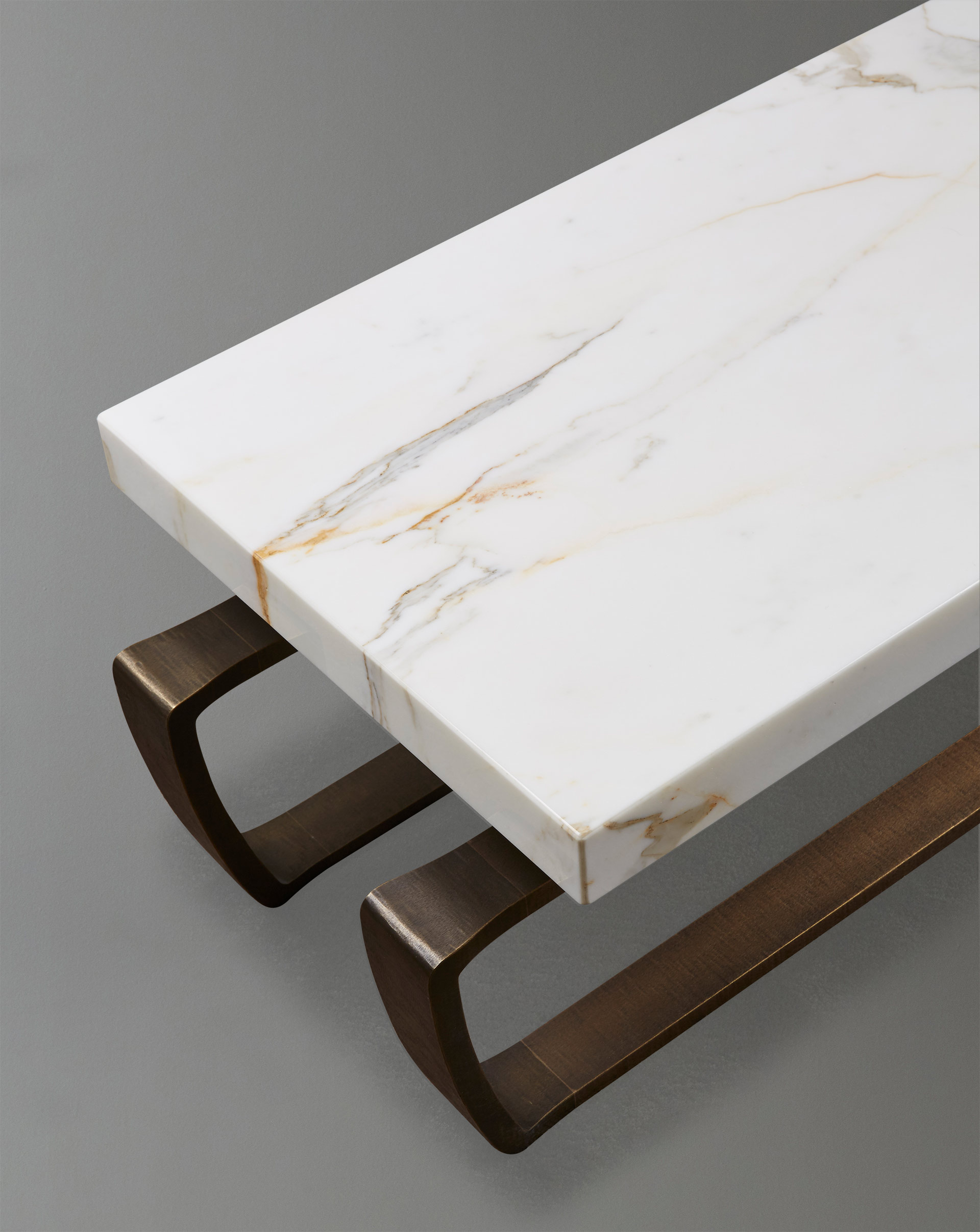 Marble top detail of Saint Moritz, a coffee table with a bronze base, from Promemoria's catalogue | Promemoria