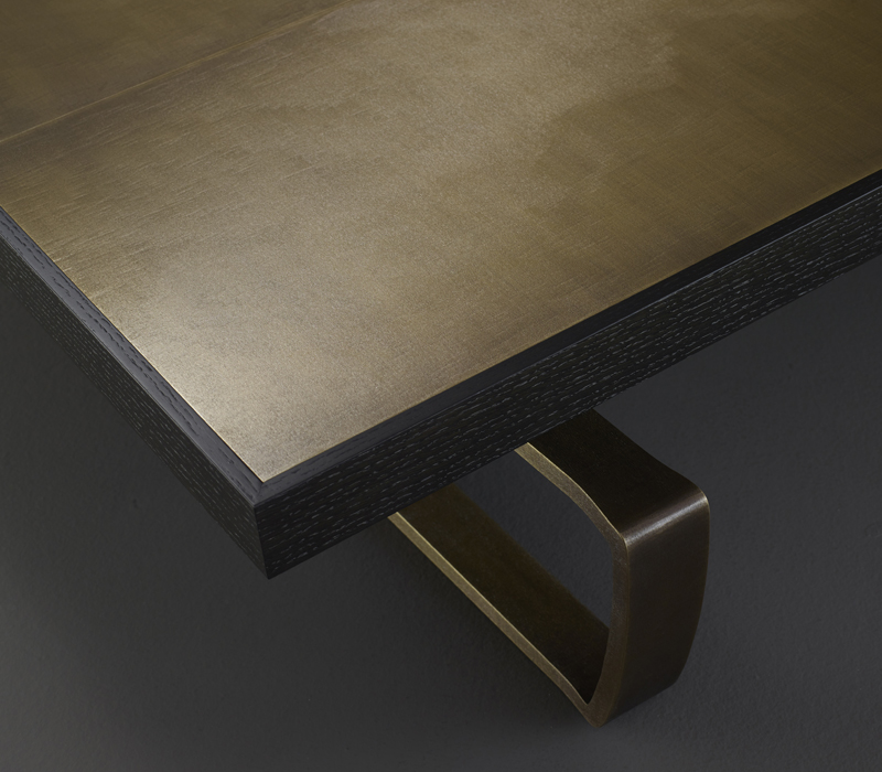 Top detail of Saint Moritz, a coffee table with wooden top and bronze base, from Promemoria's catalogue | Promemoria