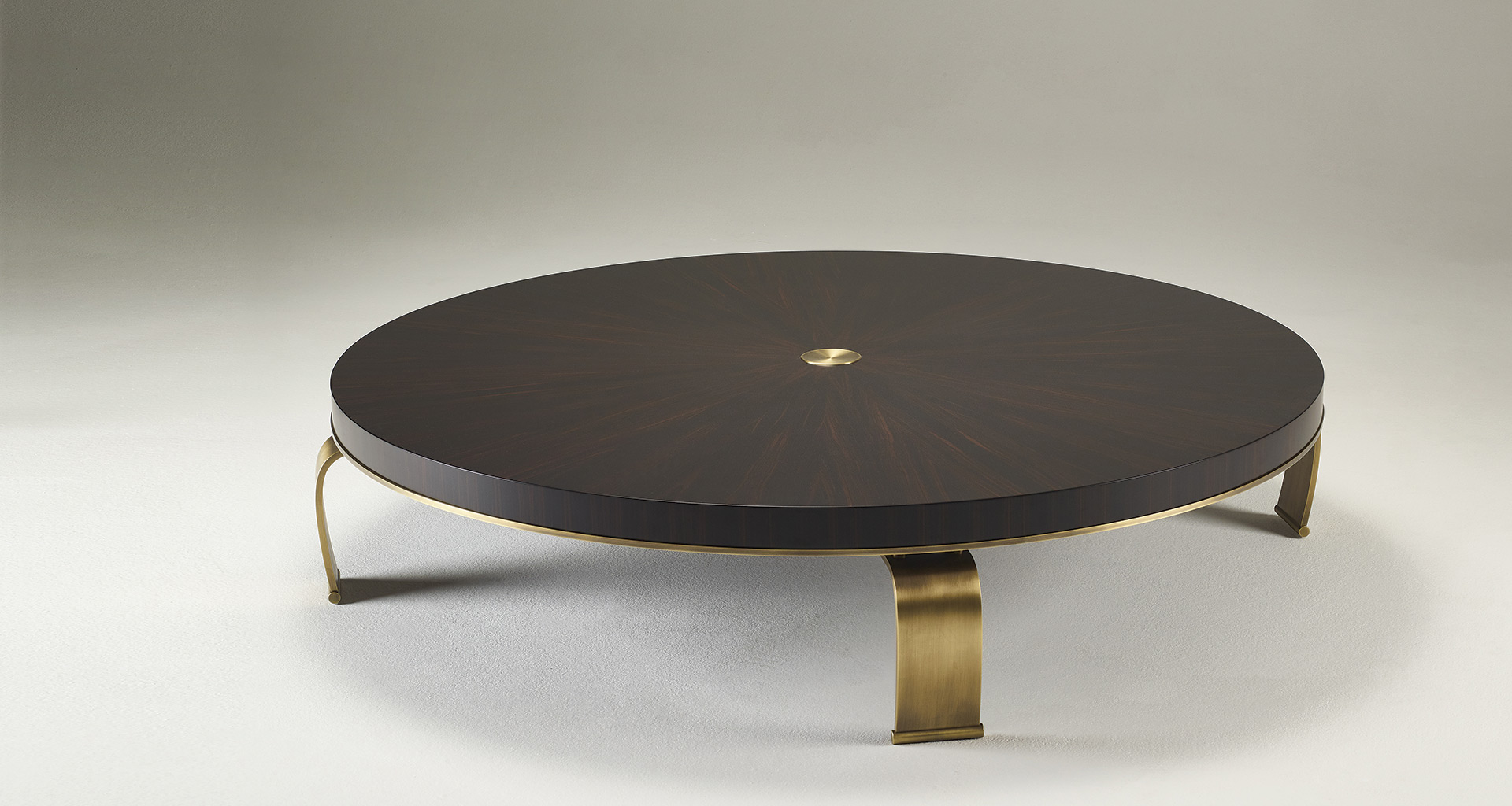 Sumo is an oval, rectangular or circular coffee table with wooden top and bronze legs, from Promemoria's Sun Tales collection | Promemoria