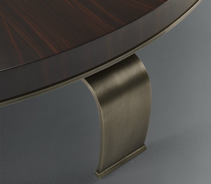 Bronze legs of Sumo, an oval or rectangular coffee table with wooden top, from Promemoria's Sun Tales collection | Promemoria