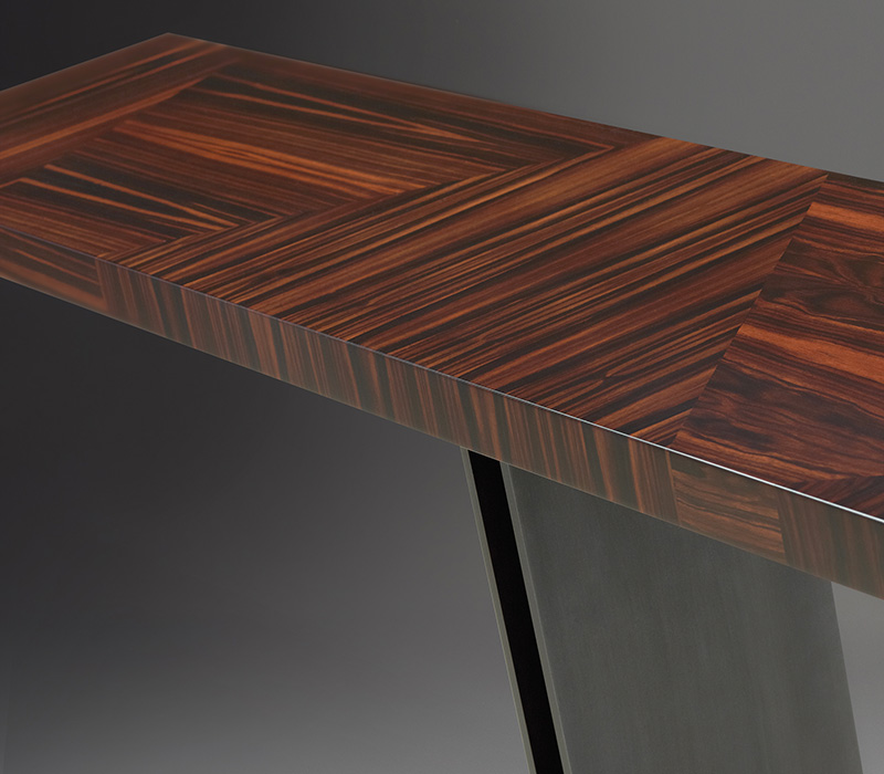 Top detail of Manfred, a bronze console with inlaid wooden top, from Promemoria's Fairy Tales collection | Promemoria
