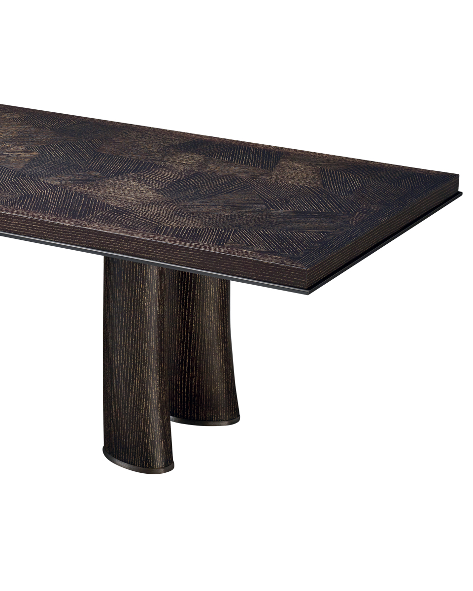 Detail of Andalù, a wooden dining table with bronze profile and feet, from Promemoria's catalogue | Promemoria