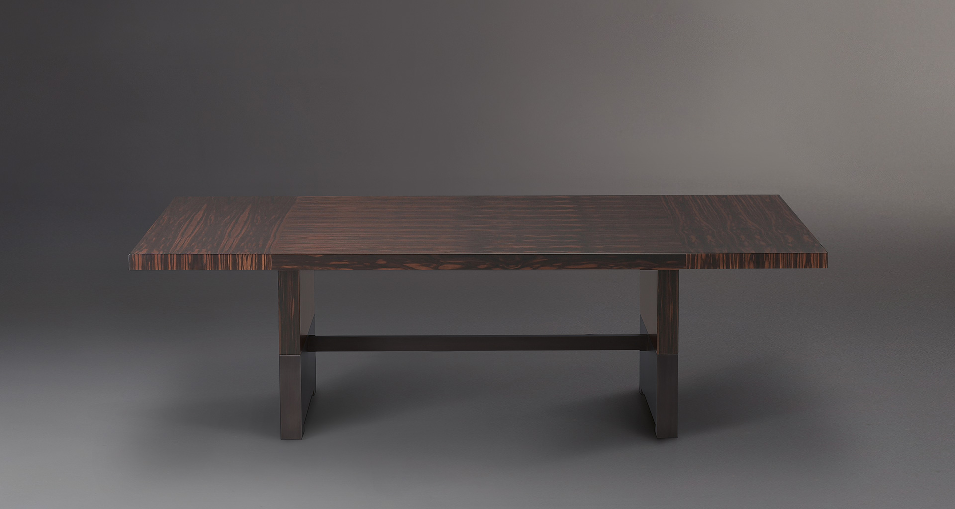 Bamboo is a wooden dining table with a bronze base, from Promemoria's catalogue | Promemoria