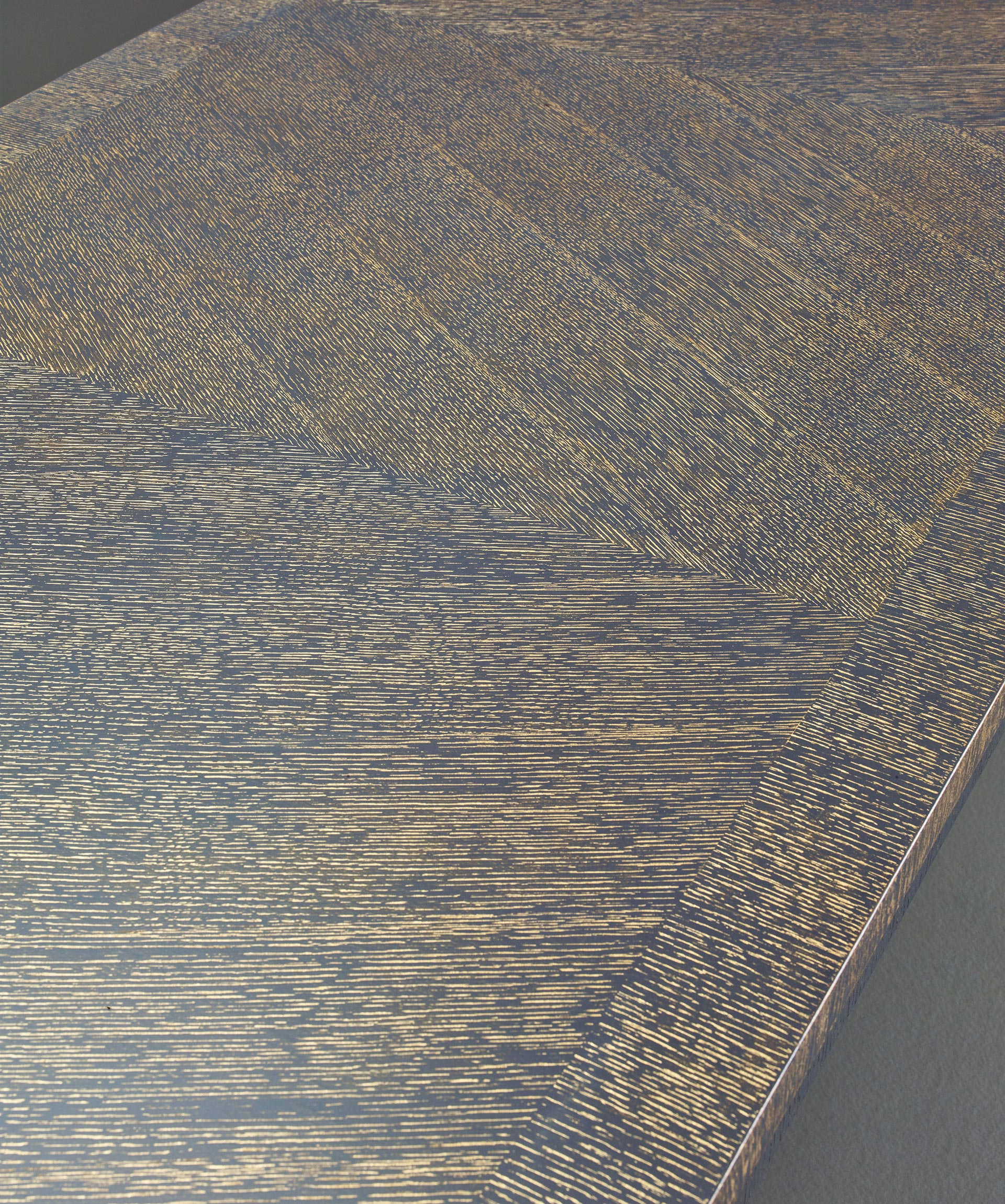Top detail of Cadogan, a bronze dining table with available in different finishes, from Promemoria's The London Collection | Promemoria