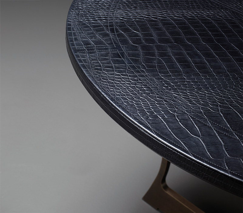 Leather top detail of Erasmo, a bronze dining table, from Promemoria's catalogue | Promemoria