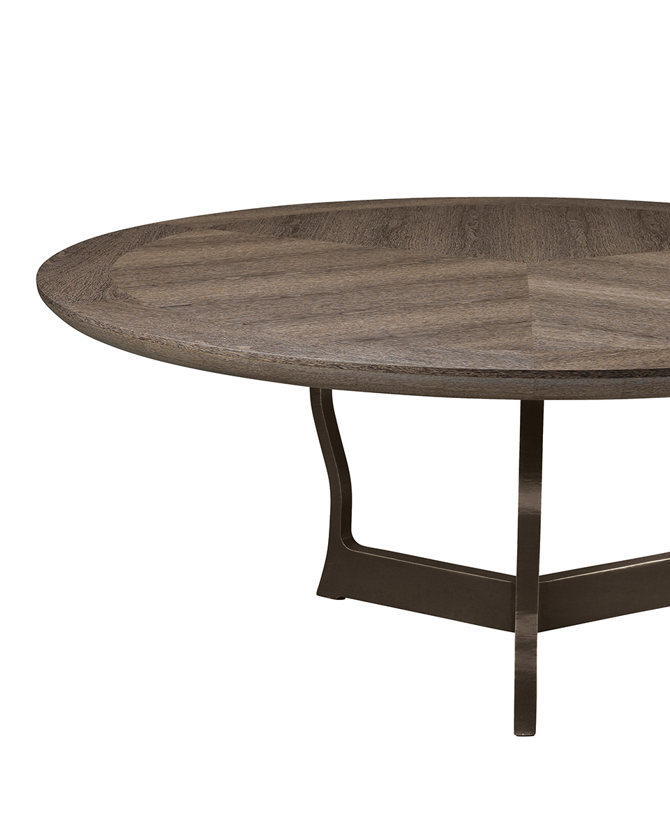 Erasmo is a bronze dining table with wooden or leather top, from Promemoria's catalogue | Promemoria