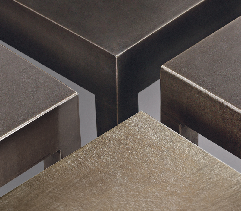 Top detail of Gong, a bronze dining table with glass top, from Promemoria's catalogue | Promemoria