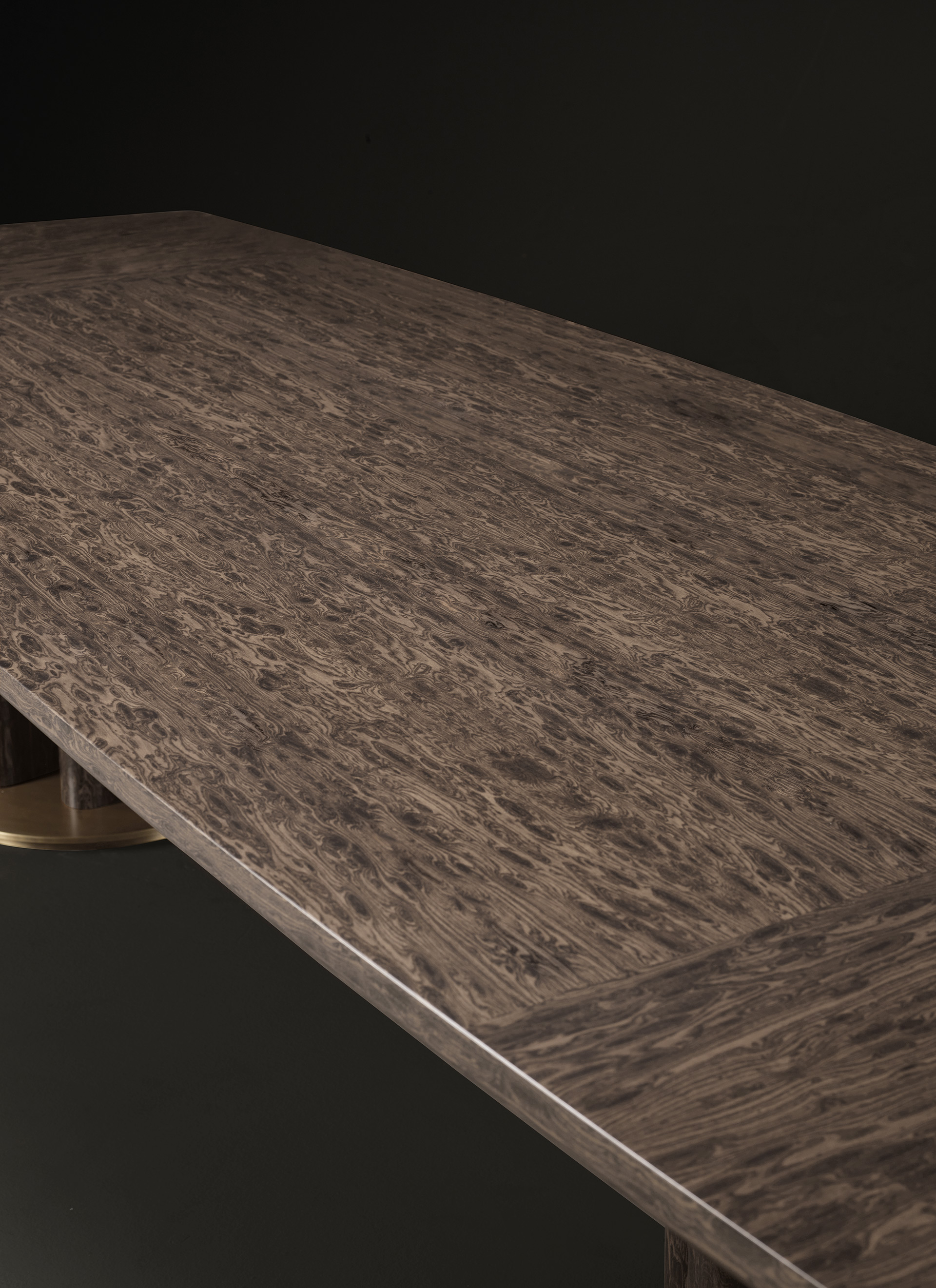 Top detail of Orazio, a wooden and bronze dining table, from Promemoria's Amaranthine Tales collection | Promemoria
