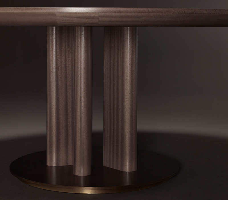 Leg and bronze base detail of Orazio, a wooden and bronze dining table, from Promemoria's Amaranthine Tales collection | Promemoria