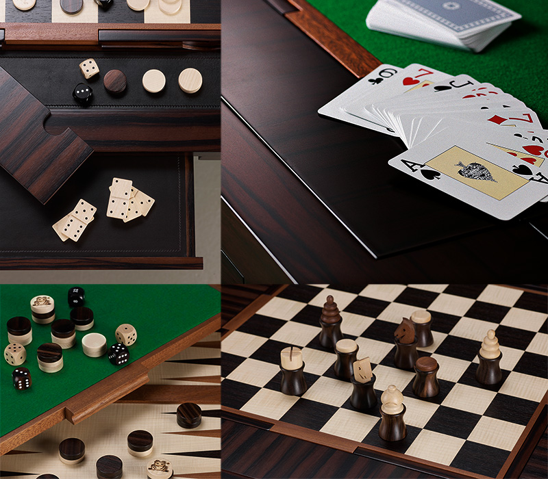 Cards, wooden dominoes, checkers, chess and dice from Bassano da gioco, wooden gaming table with bronze base equipped for several board games, from Promemoria's catalogue | Promemoria
