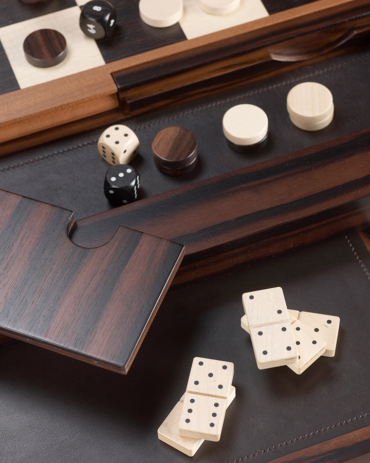 Wooden dominoes, checkers and dice from Bassano da gioco, wooden gaming table with bronze base equipped for several board games, from Promemoria's catalogue | Promemoria