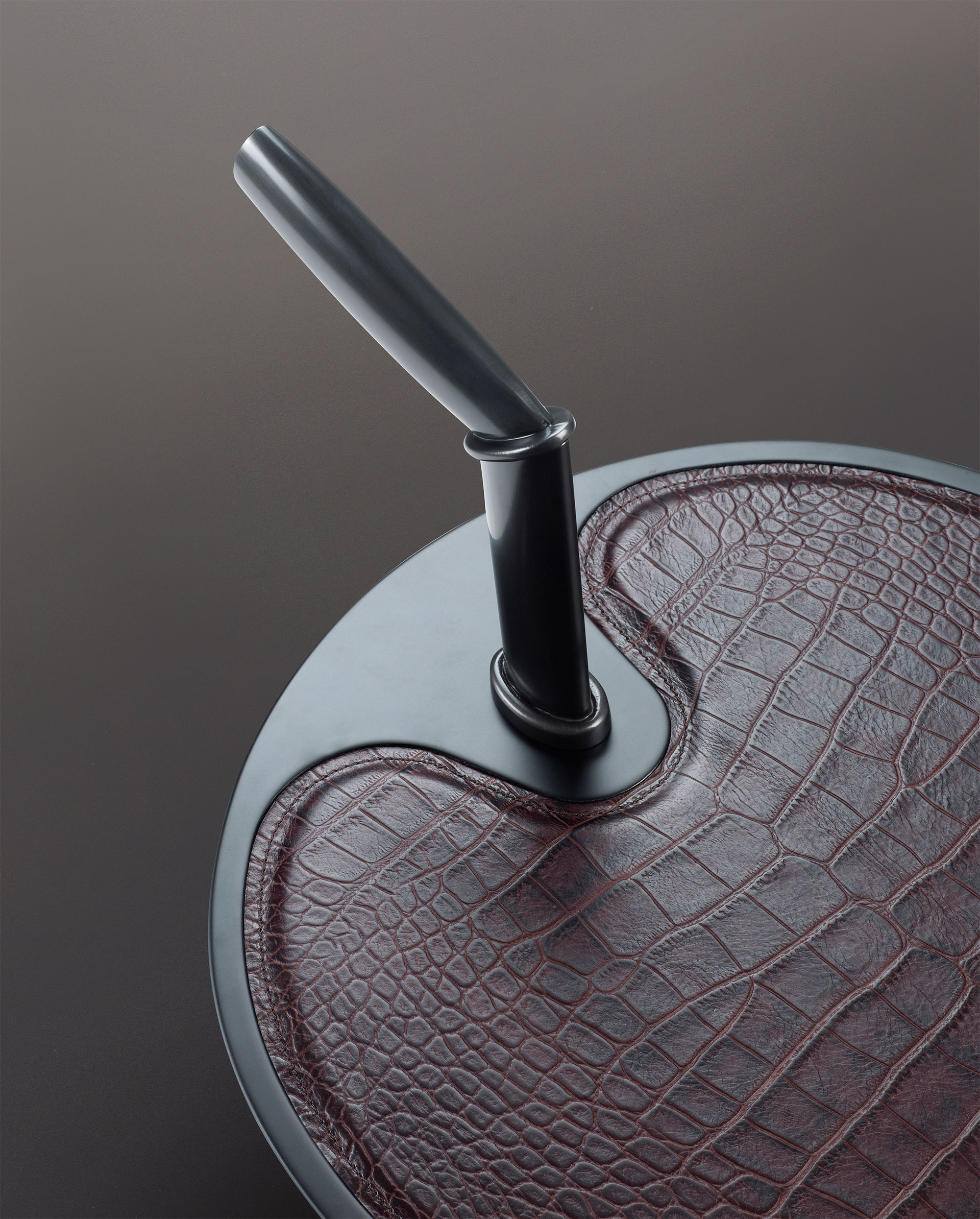 Leather top detail of Bip Bip, a bronze small table from Promemoria's catalogue | Promemoria