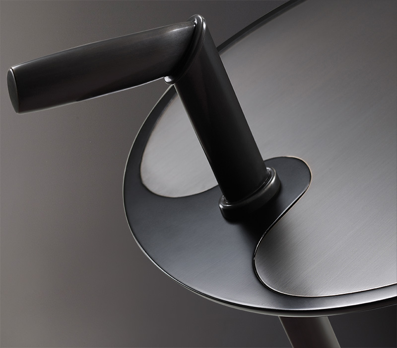 Bronze top detail of Bip Bip, a bronze small table from Promemoria's catalogue | Promemoria