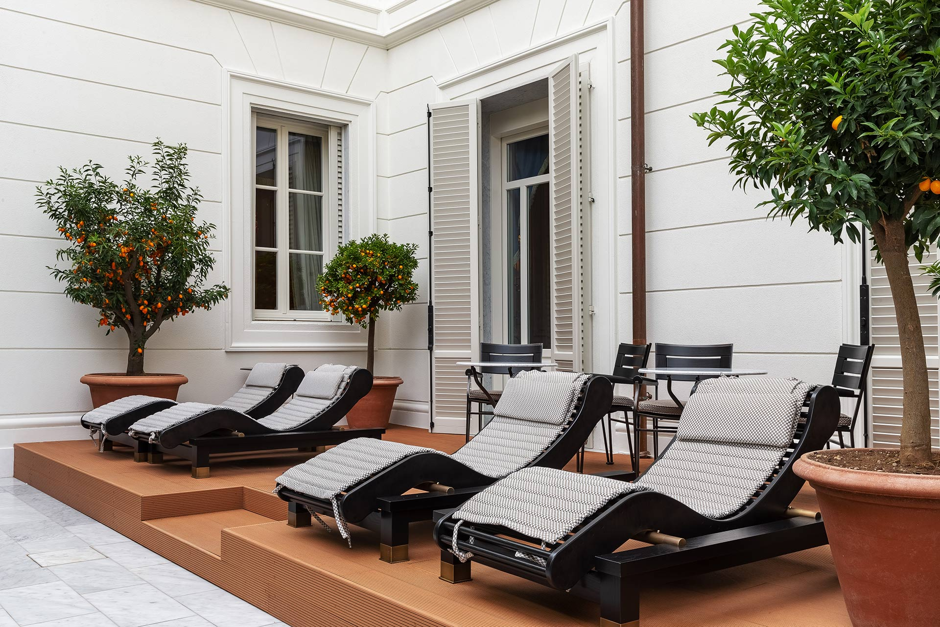 Patio of La Datcha, a luxury resort in Forte dei Marmi, Italy, furnished with Promemoria | Promemoria