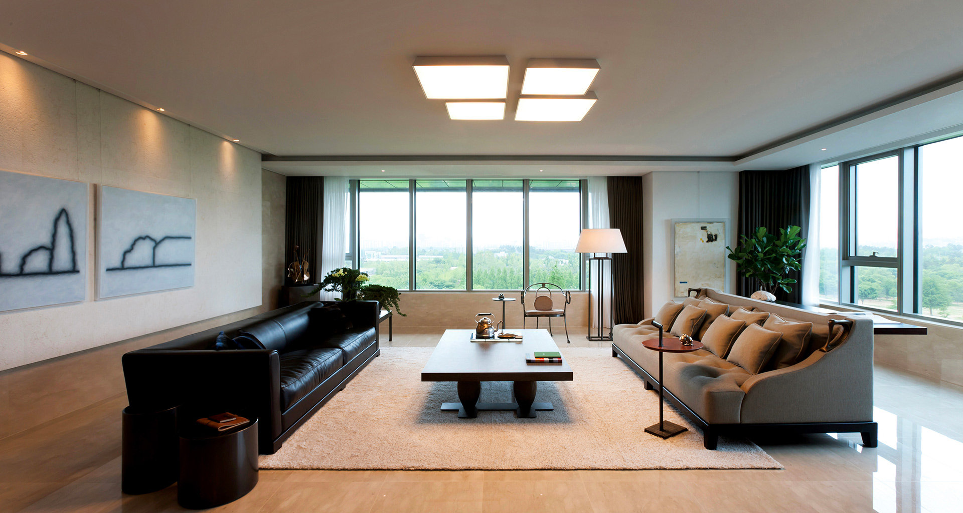 Living room of a private residence in Korea furnished with Promemoria | Promemoria