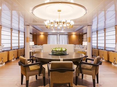 Dining room of a Yacht designed by FM Architettura and furnished with Promemoria | Promemoria
